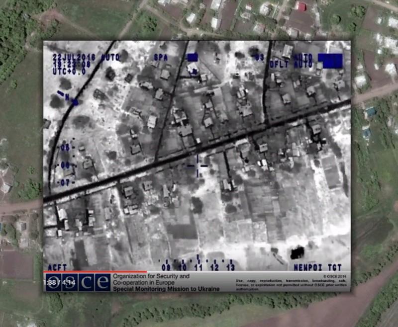Наложение скриншота видео с БЛА СММ ОБСЕ и спутникового снимка Google Earth (координаты: 48.136931, 37.651545).